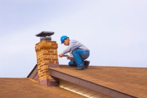 contractor working on a shifted chimney